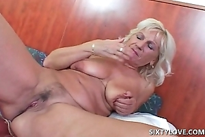 Blonde mature ID and toy bonking herself