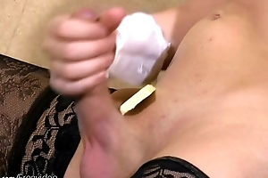 Horny tranny strips off white lingerie and fingers asshole