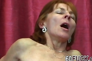 Horny granny in funereal stockings is ready be required of intense sex with younger stud