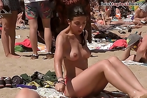 Incomparable brunette Topless on the Beach