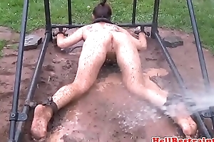 Outdoor sub humiliated with water in pillory