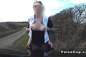 Domineer babe in arms sucks dick in fake cops auto