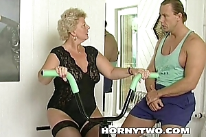 Horny granny bitch shamelessly takes gym teacher cock in mouth and fucks him