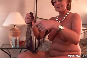 Lustful mature pleasing horny vagina in bed